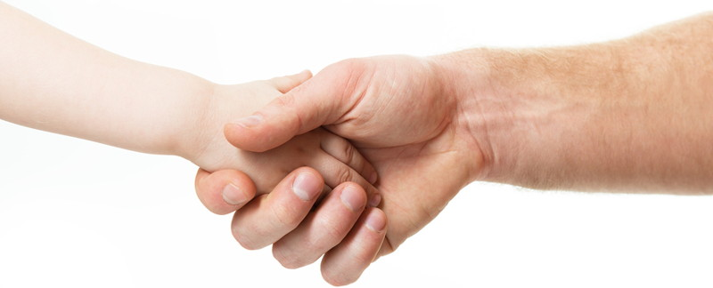 adult and child shake hands