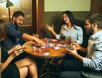 friends player poker in a pub