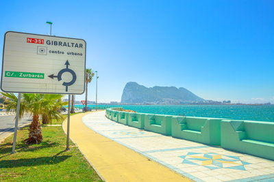 gibraltar sign with rock in background