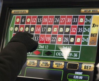 fixed odds betting terminal with game of roulette being played