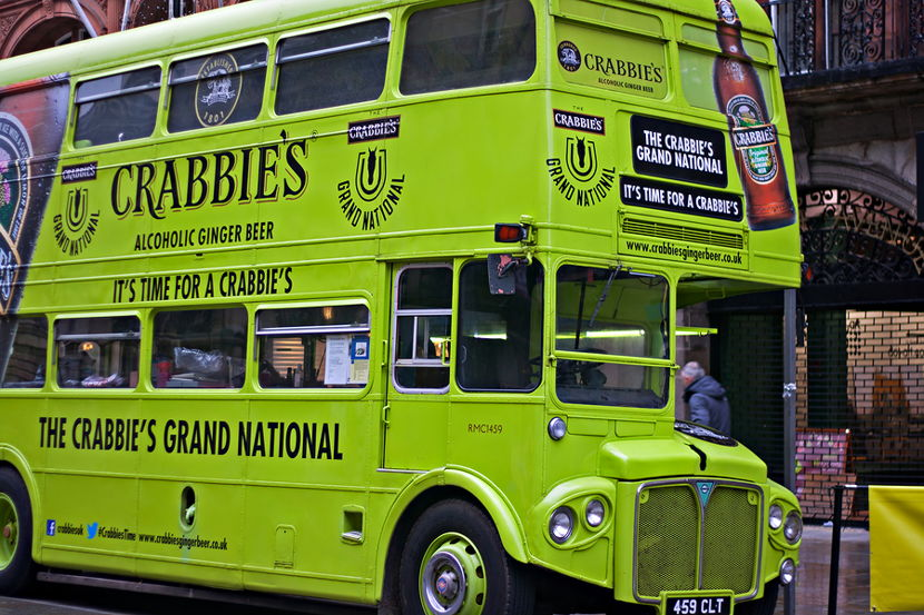 grand national bus with sponsor logos