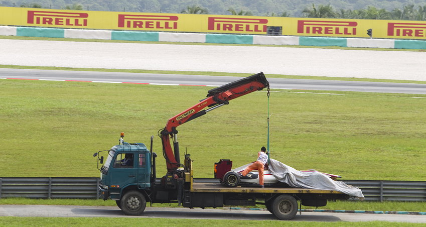 f1 car being towed away after a crash